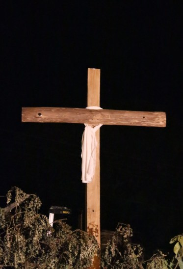 The empty cross wrapped with a shroud.