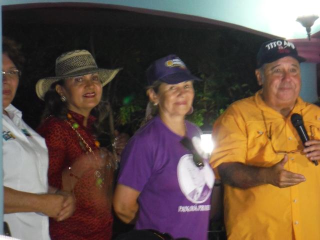 Former Presiden Mireya Moscoso in the purple shirt.