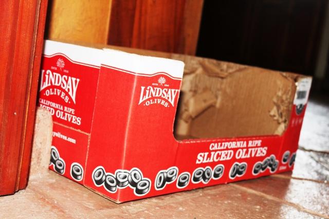 A cardboard olive box.