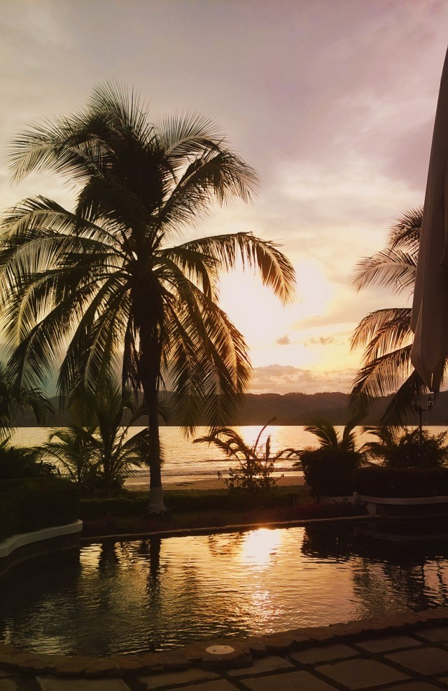 Sunset in Panama, pool, over the ocean.